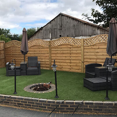 Artificial grass and Omega Fence Panel with Trellis   Chelmsford Fencing and Landscaping