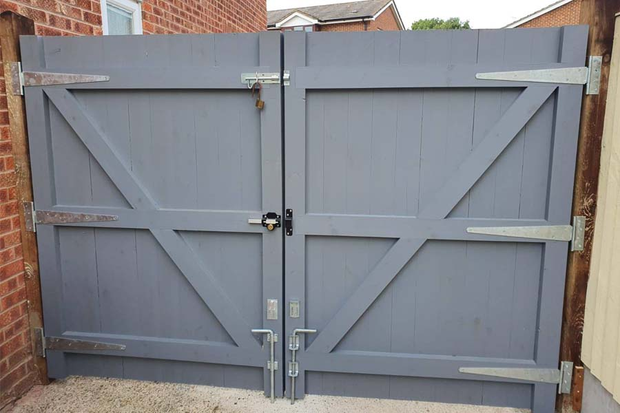 Custom built closeboard gate painted grey with Perry Lock, slide bolt and two central drop bolts   Chelmsford Fencing and Landscaping