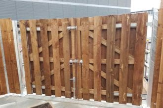 Heavy-duty hit and miss gate for industrial bin storage area   Chelmsford Fencing and Landscaping