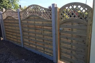 Omega style access gate with wooden plate attached to concrete post   Chelmsford Fencing and Landscaping
